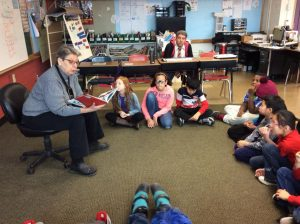 Central admin staff reads to children at SA