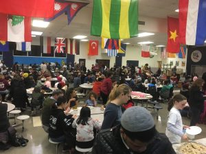 Packed Cafeteria Enjoys Drummers on Right