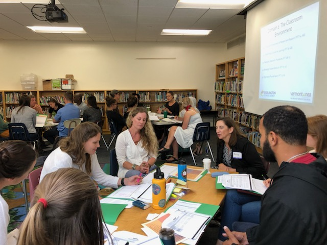 Teachers working on professional learning together around a table