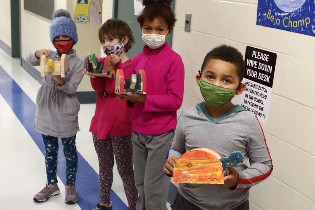 Children showing their artwork